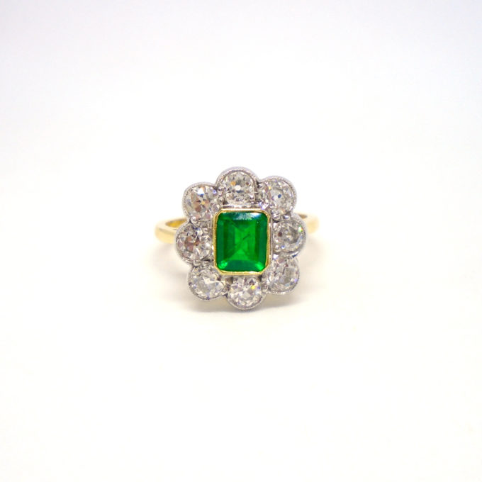 Front of emerald and diamond ring