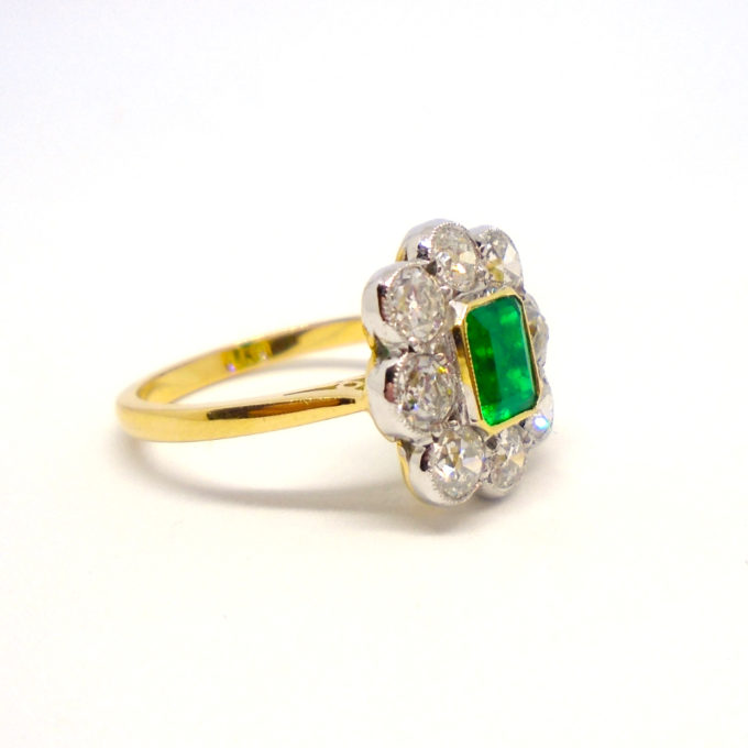 Emerald and diamond cluster ring with gold shank