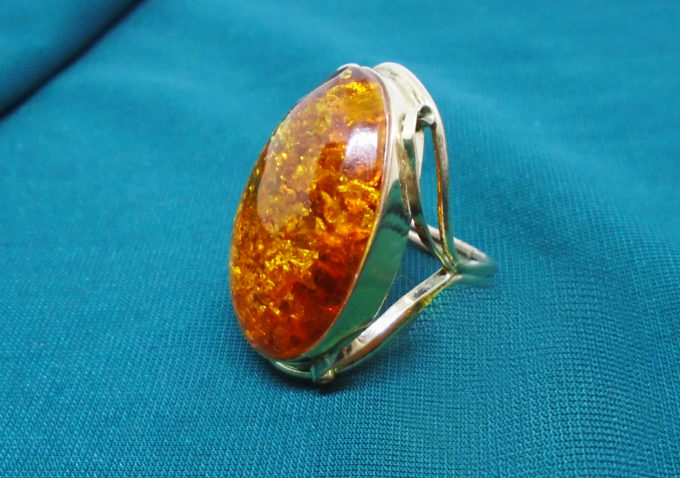 A chunky oval amber in a silver ring