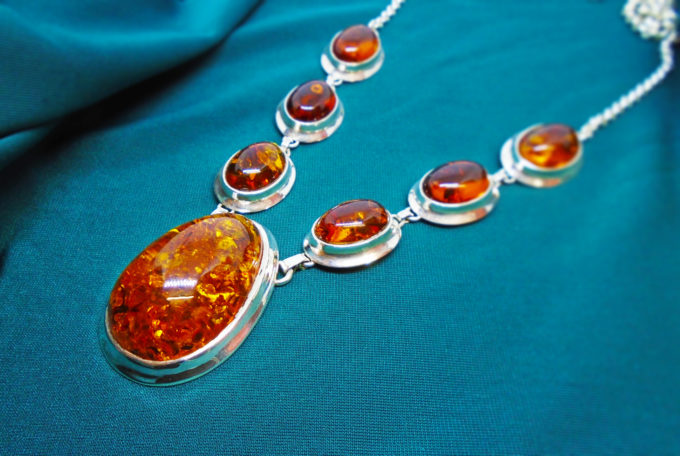 6 small amber chunks lead down to one large centre amber on this necklace