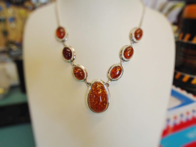7 amber necklace on a bust