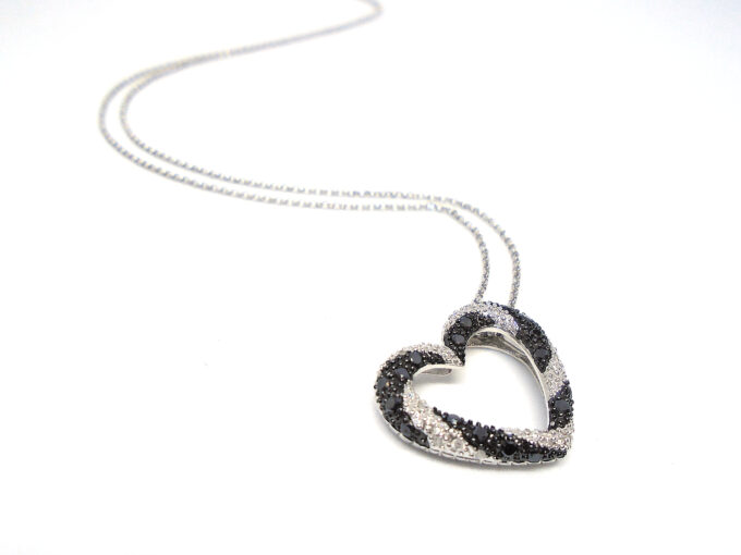 Heart shaped pendant on a silver chain.